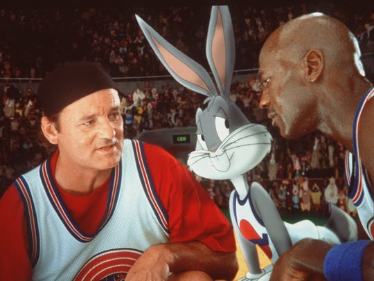 Bill Murray (left) talks game strategy with Bugs Bunny