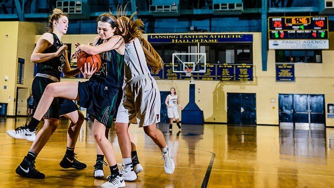 Kenzie Lewis ,foreground, of Williamston grabs a defensive rebound in front of Lauren Russell ,right, of Portland early in the 4th quarter of their Class B regional championship game Thursday March 9, 2017 at Don Johnson Fieldhouse in Lansing.  KEVIN W. FOWLER PHOTO