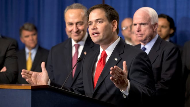 Sen. Marco Rubio, R-Fla., flanked by Sens. Charles Schumer, D-N.Y., left, and John McCain, R-Ariz., discusses immigration in April.