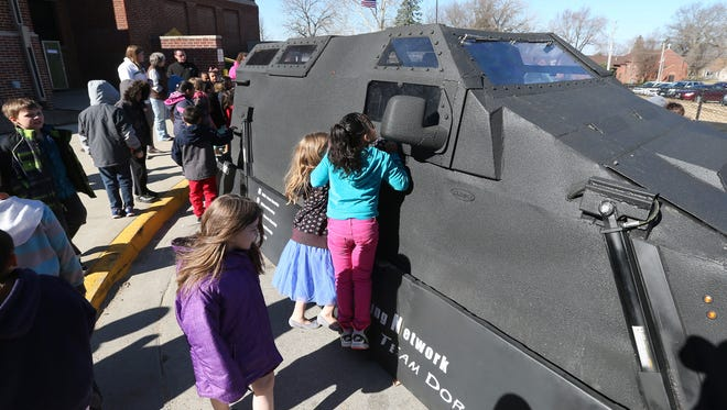 Members of the Iowa Storm Chasing Network spoke with students at Stowe Elementary School in Des Moines on Thursday. The class got to get up close with Dorothy, a 5-ton vehicle the chasers use when they encounter tornados.