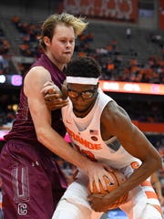 Colgate Raiders center Dana Batt (12) and Syracuse Orange center Paschal Chukwu (13) battle for the ball during the second half at the Carrier Dome.