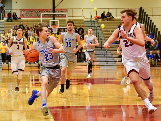 Lakeland's Kyle Flowers (left) drives to the basket with Milford's Kyle Soderberg in pursuit.