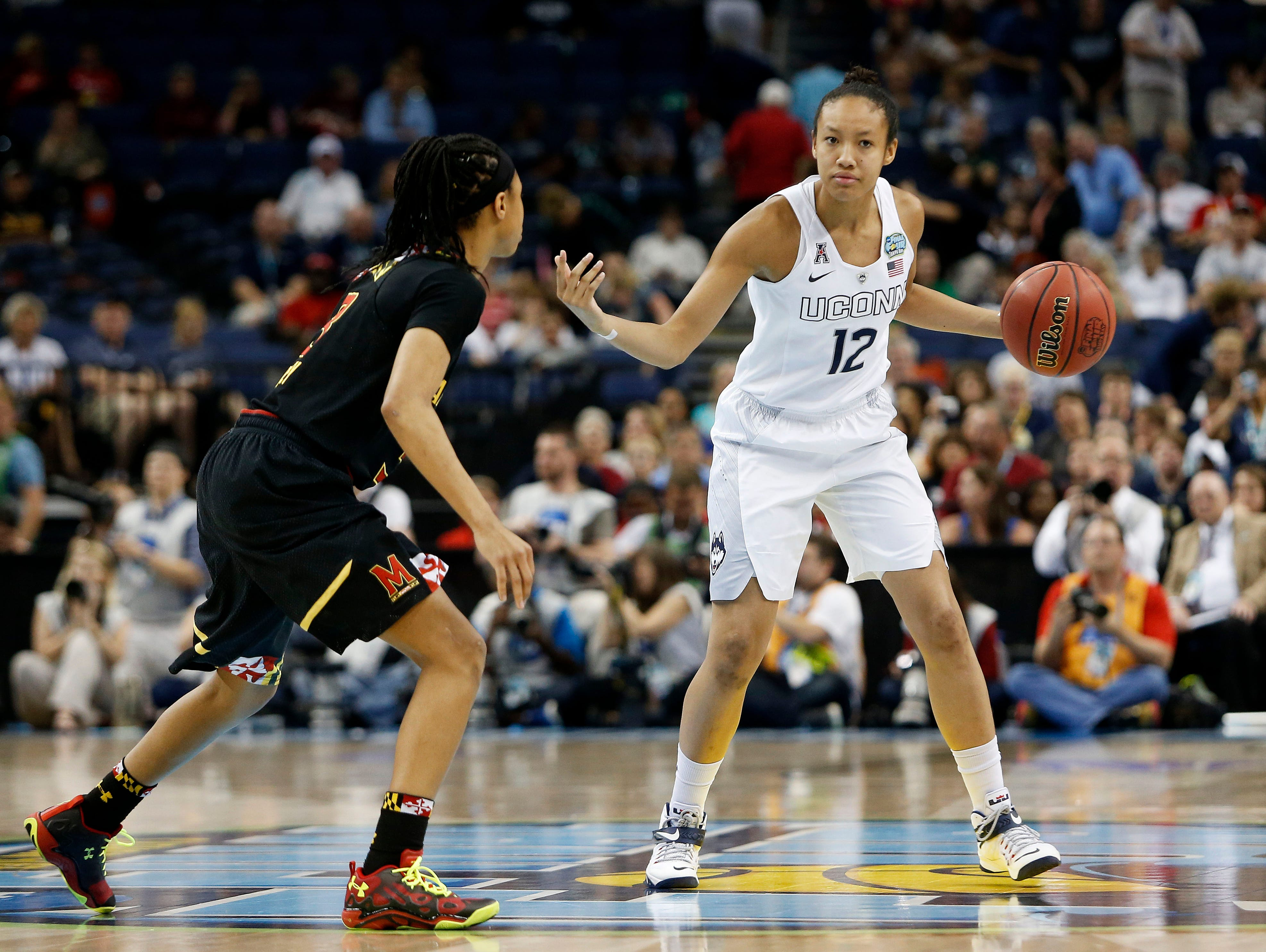 UConn's Saniya Chong, right, of Ossining, is shown here against Maryland in an NCAA women's national semifinal at Amalie Arena on April 5, 2015, in Tampa, Florida,.