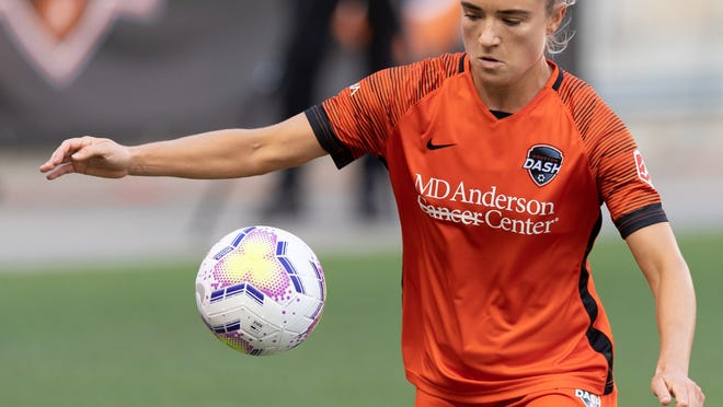 HOUSTON, TX - OCTOBER 4: Kristie Mewis #19 of the Houston Dash gains control of a loose ball during  a game between North Carolina Courage and Houston Dash at BBVA Stadium on October 4, 2020 in Houston, Texas.