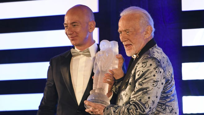 Jeff Bezos of Blue Origin receives the Buzz Aldrin Space Innovation Award from its namesake at the 2017 Apollo 11 Anniversary Gala at the Apollo/Saturn V Center. Aldrin's intergalactic-chic tux was designed by Nick Graham.