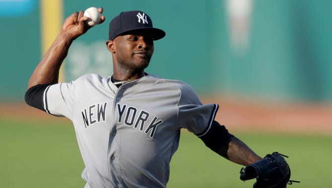 New York Yankees starting pitcher Domingo German delivers during the first inning of the team's baseball game against the Cleveland Indians, Friday, July 13, 2018, in Cleveland.