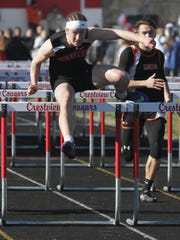 Crestview's Cameron Shifflet wins the 110 high hurdles in leading the Cougars to their fifth straight title in their own invitational.