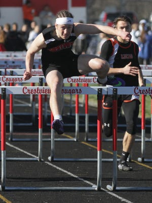 Crestivew's Cameron Shifflet, in this file photo, was a triple winner in leading the Cougars to a Firelands Conference title, setting a meet record in the 300 meter hurdles.