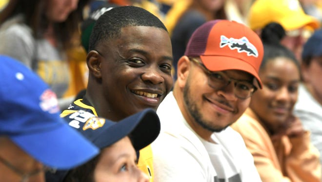 Waffle House hero James Shaw Jr. sits in the stands after being introduced during the first period in Game 2 of the second-round NHL Stanley Cup Playoffs at Bridgestone Arena on April 30, 2018, in Nashville.