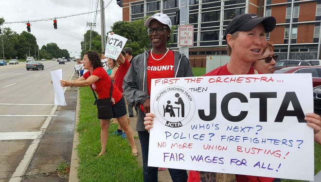 Teachers protest outside JCPS headquarters over contract negotiations.