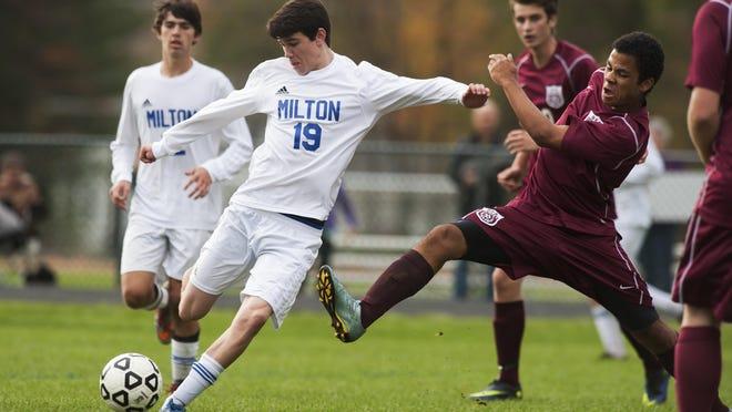 Milton's Ryan Brown (19) takes a shot during the boys soccer game against BFA-Fairfax last season.