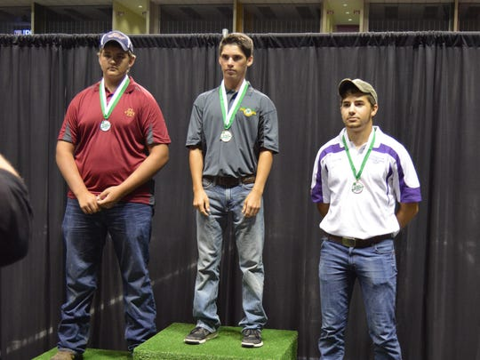 Sean Craig Jr. of Pineville (far right) stands on the bronze medalist tier of the medal stand after the 3D shooting competition at the 4-H Shooting Sports National Championships in Grand Island, Nebraska. Tad Terrell of Missouri (center) won the event, and Collin Harris of Iowa (far left) was the runner-up.