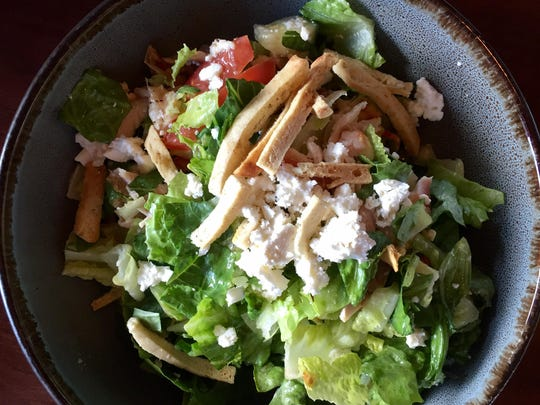 Redwood salad at the new Redwood Rotisserie & Grill features rotisserie chicken and pita strip croutons.