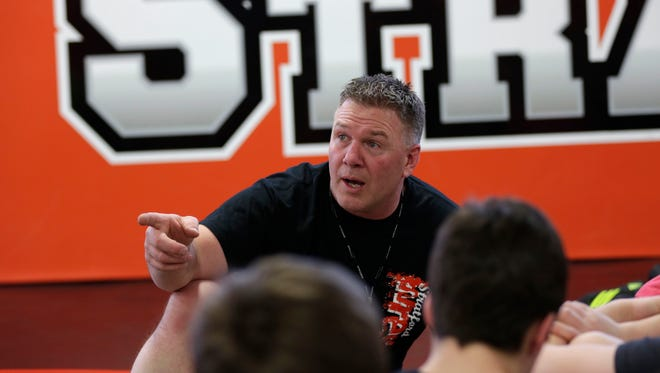 Joe Schwabe, head coach for Stratford's wrestling team, gives instruction during a practice at the school on Feb. 29.