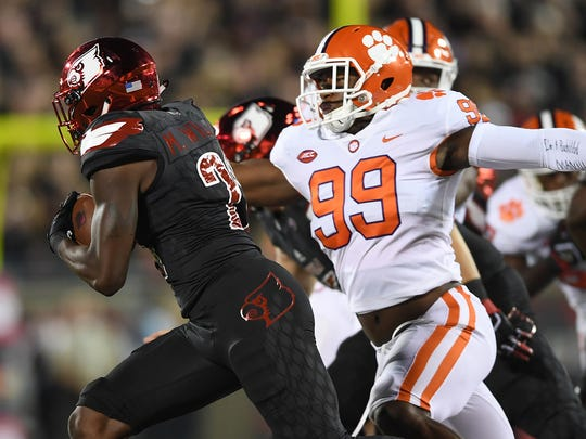 Clemson defensive lineman Clelin Ferrell (99) pressures Louisville running back Malik Williams (29) during the 1st quarter on Saturday, September 16, 2017 at Louisville's Papa John's Cardinal Stadium.
