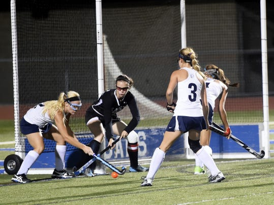 Chambersburg's Molley Keefer (12) scores a goal against CD East on Wednesday. The Trojans piled up the goals in an 11-0 win over the Panthers.