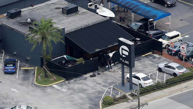 In this June 12, 2016, file photo, law enforcement officials work at the Pulse nightclub in Orlando following the a mass shooting.