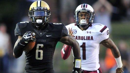 Vanderbilt's Darrius Sims returns a kickoff 91 yards for a touchdown.