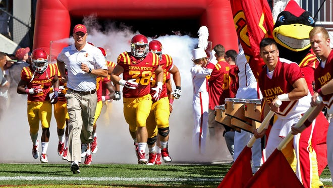 Iowa State head coach Paul Rhoads, center, leads his team through the tunnel onto the field before football game against Kansas State at Jack Trice Stadium in Ames on Saturday Sept. 6, 2014.