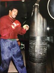 Alonzo Highsmith hits the heavy bag during training.