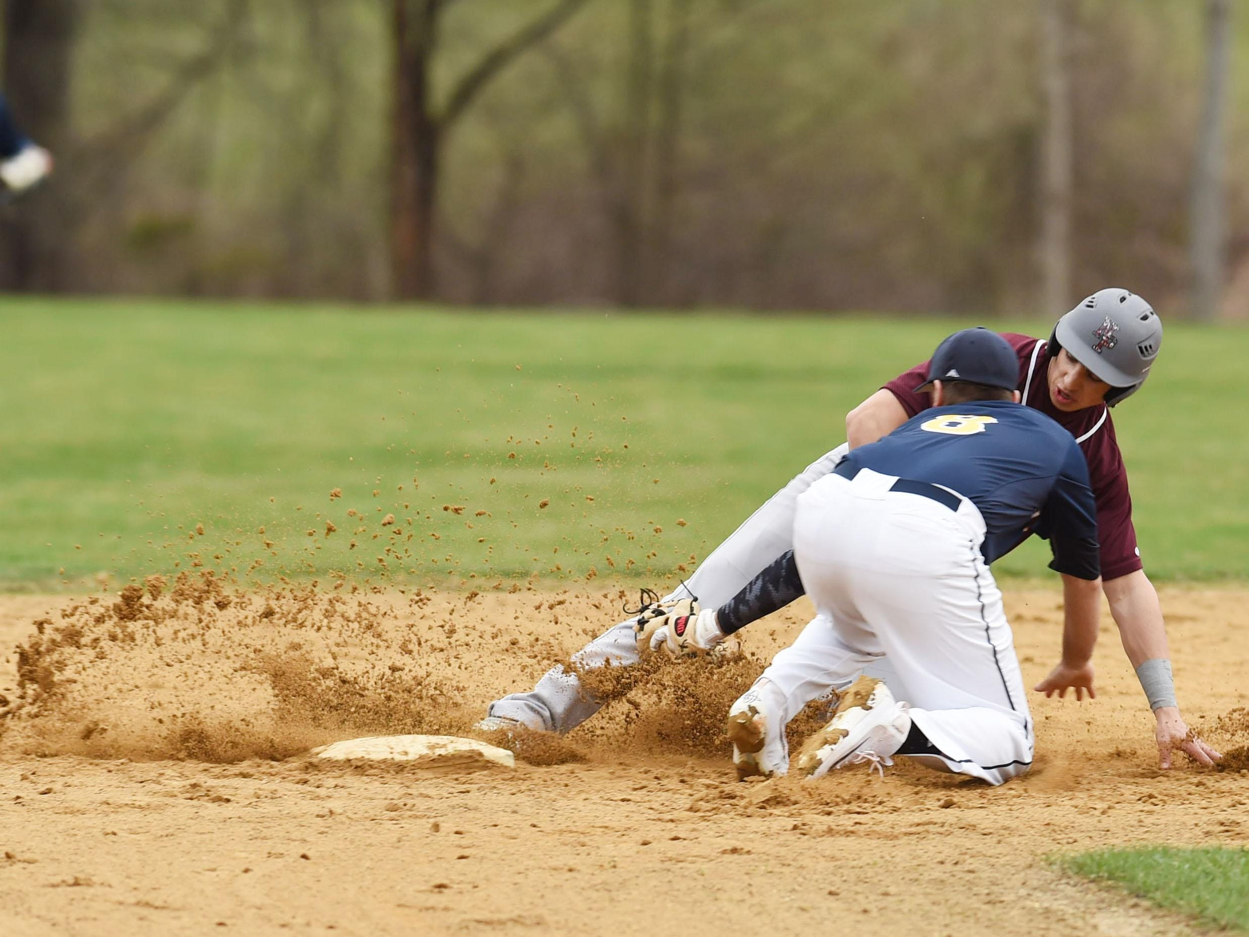 Highland's Kevin Brennie tags New Paltz's Joe DiMarco at second during Monday's game.