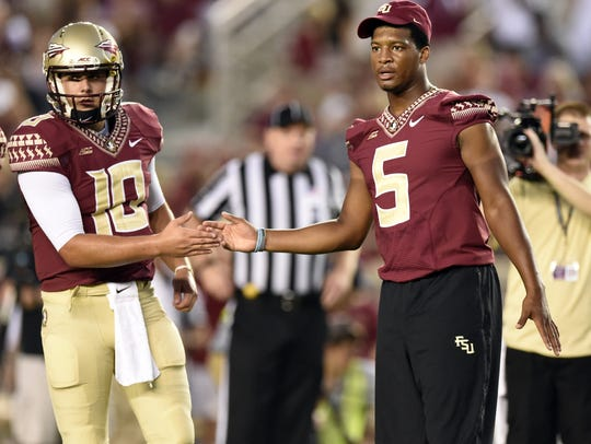 Sean Maguire and Jameis Winston shake hands before