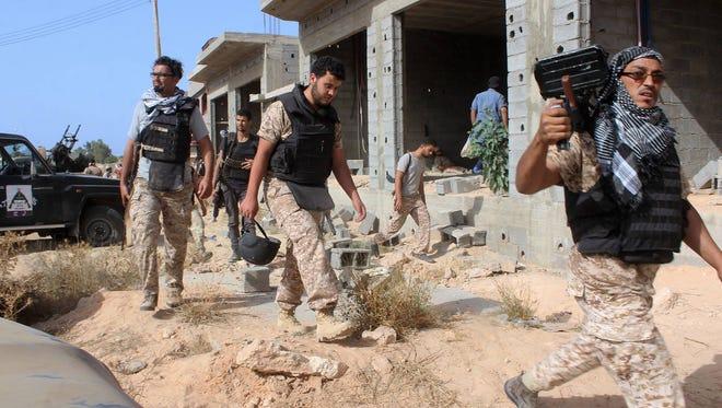 A handout picture taken on June 21, 2016 and released on June 22, 2016 by the media centre of the forces of Libya's Government of National Accord's (GNA) military operation against the Islamic State group in Sirte reportedly shows GNA fighters taking part in an operation against IS jihadists in the city of Sirte.
