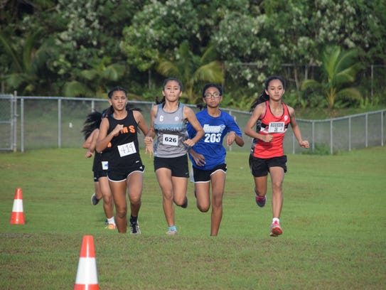 The top female runners go neck-and-neck at the Guam