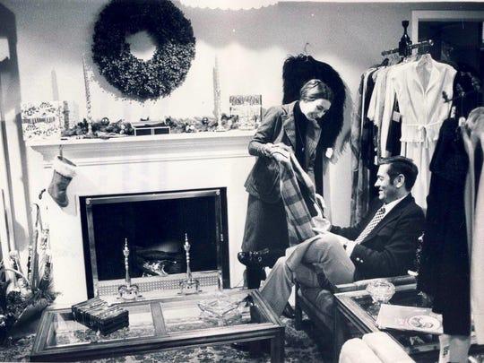 Glenda Nelson shows merchandise to Gene Best Dec. 22, 1976 at the Stag Shop at Stewart's on Fourth Street i downtown Louisville.