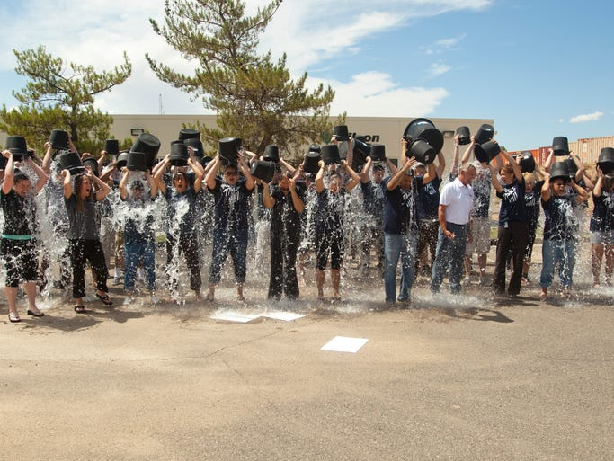 Employees of Wilson Electronics in St. George accept the ice bucket challenge Thursday, Aug. 21, 2014.