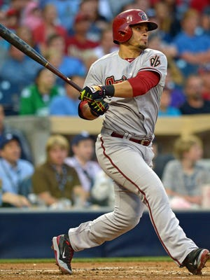 Diamondbacks right fielder Gerardo Parra (8) follows through on a swing during the second inning against the San Diego Padres at Petco Park.