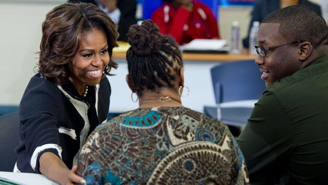 Michelle Obama talks with students, parents and counselors during a FAFSA workshop in February.