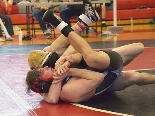 Buffalo Gap's Cullen Bendel, the All-City/County Wrestler of the Year, has East Rockingham's Dustin Dover locked up in a cradle during their 138-pound semifinal bout at the Shenandoah District tournament on Feb. 3, 2018, at Stonewall Jackson High School in Quicksburg, Va.