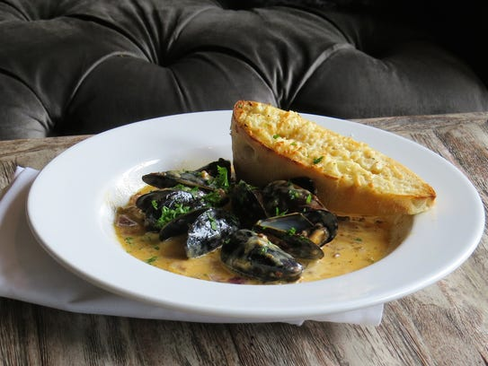 A lunchtime order of chorizo mussels in tequila cream