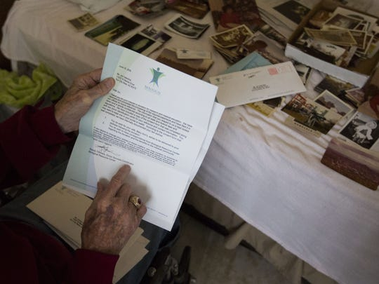Jimmy Valentine holds the letter confirming his late wife's body would be used for medical research.