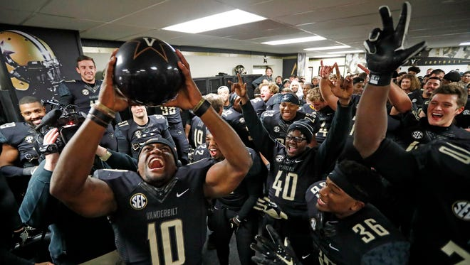 Vanderbilt wide receiver Trent Sherfield (10) holds up a bowling ball to celebrate bowl eligibility after beating Tennessee on Nov. 26.