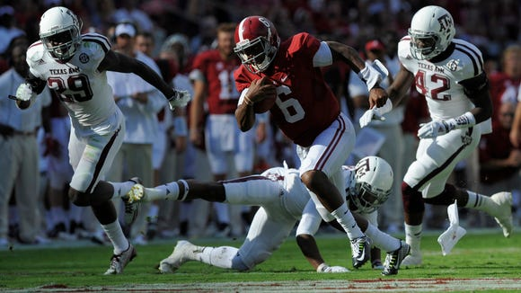 Alabama quarterback Blake Sims (6) gets by Texas A&M defenders for a touchdown in the second quarter at Bryant-Denny Stadium in Tuscaloosa, Ala. on Saturday October 18, 2014.
