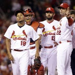 Cardinals starting pitcher Carlos Martinez, left, exited Friday night's game against the Pittsburgh Pirates in the top of the fourth inning due to fatigue.