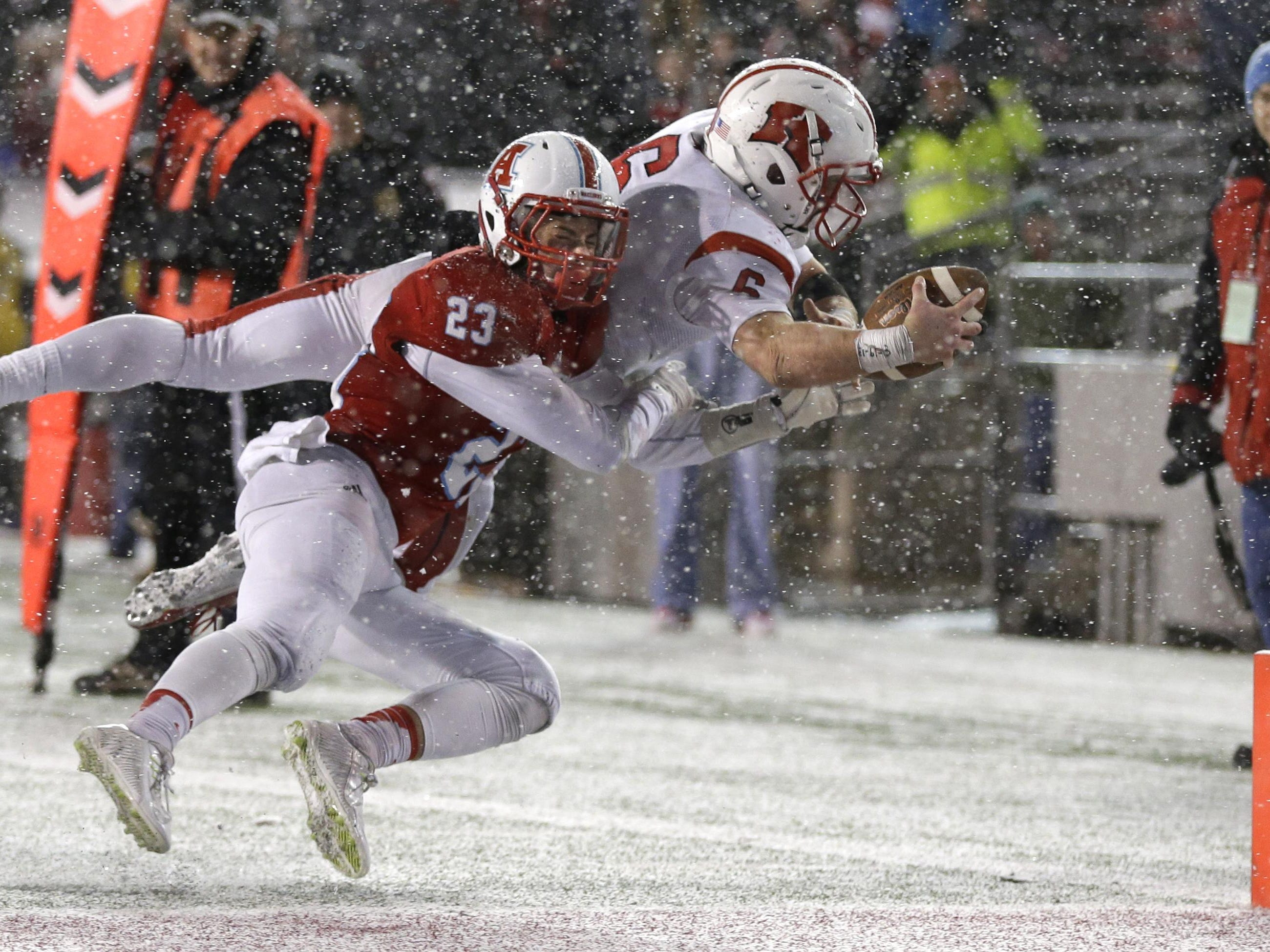 Kimberly's Blair Mulholland is knocked out of bounds just short of a touchdown in the fourth quarter Friday in Madison.