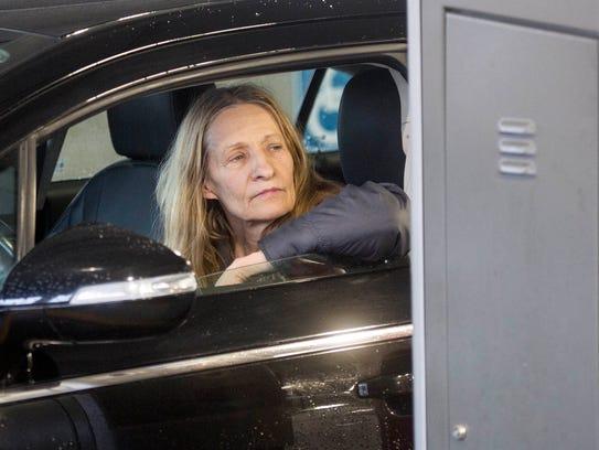 Former Macomb Co. Clerk Karen Spranger exits the county
