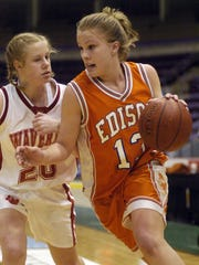 Erica Schiefen drives with the basketball for the Edison