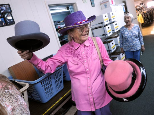 """Inger Svalling holds up some of the hats she was donating to the Thrift House Sept. 1, 2017. """"I buy more than I bring,"""" she said, laughing. The resale store is a ministry of the Church of the Heavenly Rest and will celebrate 65 years this month."""