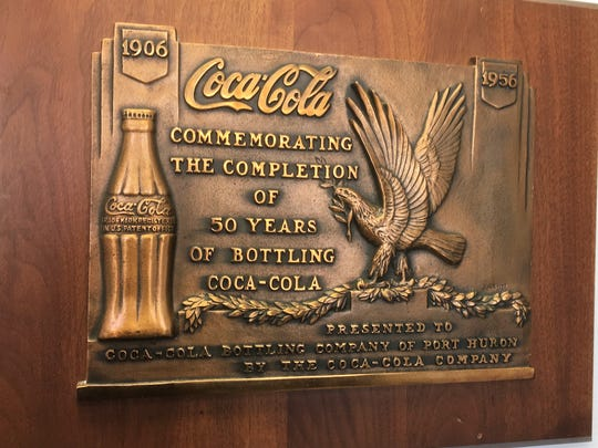 The lobby of the Port Huron branch of Great Lakes Coca-Cola bottling has plaques commemorating the Coca-Cola's history in Port Huron.