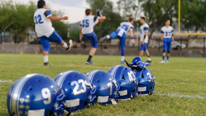 Bagdad players warm up before their high school football game against NFL Yet Academy on Friday, Sept. 22, 2017, at NFL Yet Academy in, Phoenix Ariz.