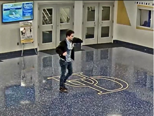 UD police are looking for this man who they say set a trash can on fire at the campus ice arena.