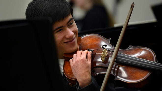 Nicholas Ngo participates in orchestra class at De Pere High School. Ngo also is the principal viola in the Green Bay Youth Symphony.