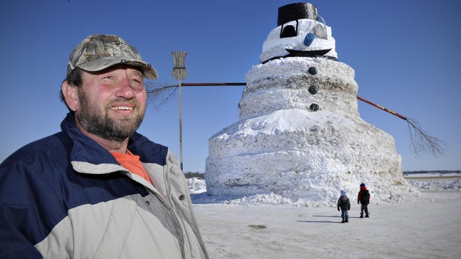 Greg Novak, Gilman, talks about the construction of his 50-foot-high snowman named Granddaddy on his farm in 2014.