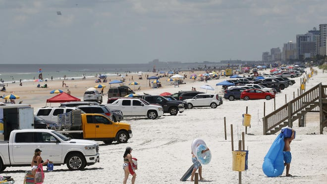 Crowds were already packing the beach on Thursday in Daytona Beach, in anticipation of the Fourth of July holiday weekend. Large crowds are expected despite Florida surpassing a record 10,000 coronavirus cases on Thursday.