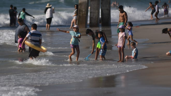 State environmental officials are advising beachgoers to avoid swimming in areas where flood water caused by recent heavy rainis being pumped into the ocean.