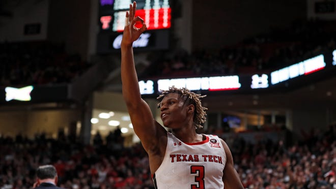 Texas Tech's Jahmi'us Ramsey (3) celebrates after scoring a three-point basket during the first half of a Big 12 Conference game Feb. 10 against TCU at United Supermarkets Arena. Ramsey is expected to hear his name called in the first round of the NBA Draft set to take place virtually on Wednesday.